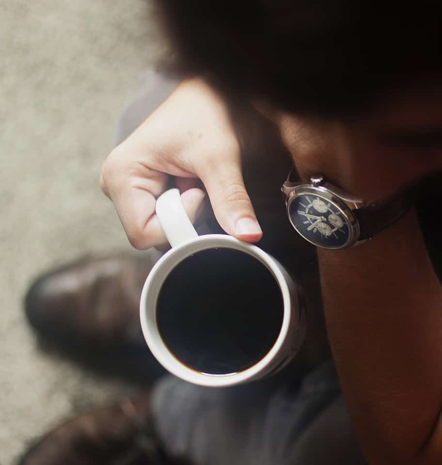 Man waiting for at fertility check with a cup of coffe