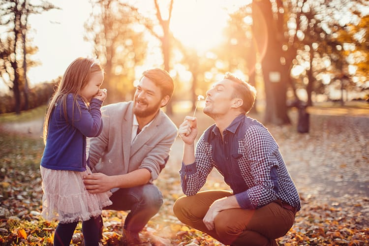 A homosexual couple with their daughter who is conceived via a surrogate