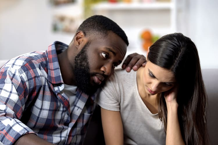 A sad couple after experiencing early pregnancy loss