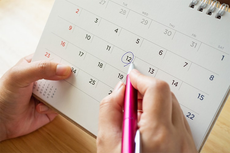 Woman with a calendar marking the first day of her fertile window