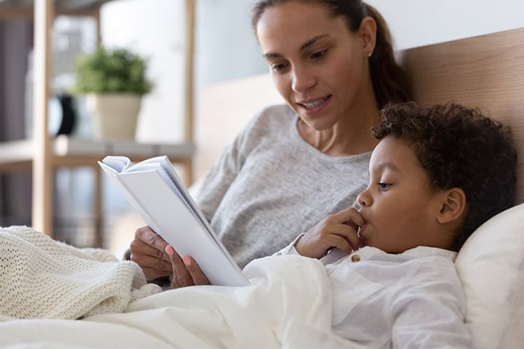 An American mother reading a book to her child about adoption