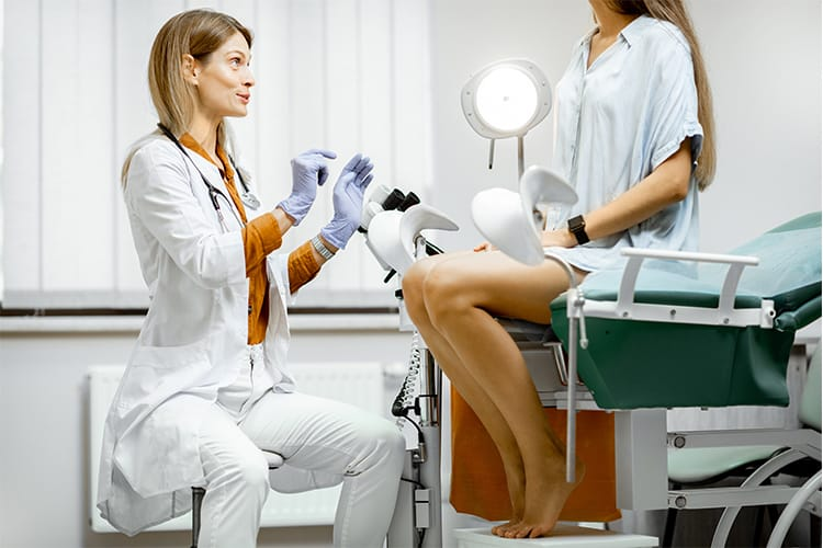 Doctor and woman talking before an egg retrieval procedure