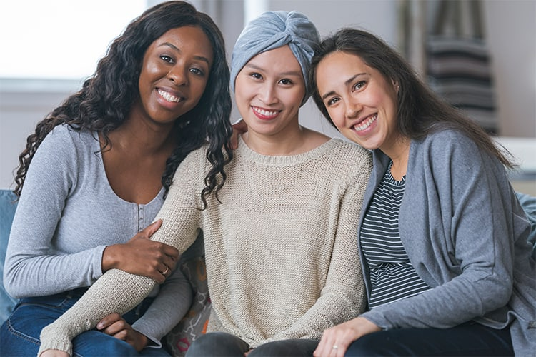 A woman with cancer getting support from her friends